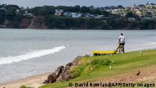 05.03.2021 A man looks out onto a beach following a tsunami warning in Orewa, north of Auckland, on March 5, 2021, as tens of thousands of coastal residents in New Zealand, New Caledonia and Vanuatu fled for higher ground as a cluster of powerful earthquakes sparked a Pacific-wide tsunami alert. (Photo by DAVID ROWLAND / AFP) (Photo by DAVID ROWLAND/AFP via Getty Images)