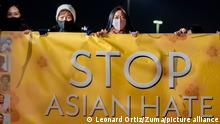 March 4, 2021, Fountain Valley, California, USA: Linda Nguyen, right, a victim of Asian hate, joins members of the Vietnamese community and others hold up a banner against Asian hate during a gathering at Fountain Valley Sports Park in Mile Square Park in Fountain Valley on Thursday, March 4, 2021 to commemorate the one year of the coronavirus pandemic and honor those who have died and to bring attention to the growing number of anti-Asian hate crimes where Asian Americans have been subject to hate because they have been linked to bringing the virus. (Credit Image: © Leonard Ortiz/Orange County Register via ZUMA Wire