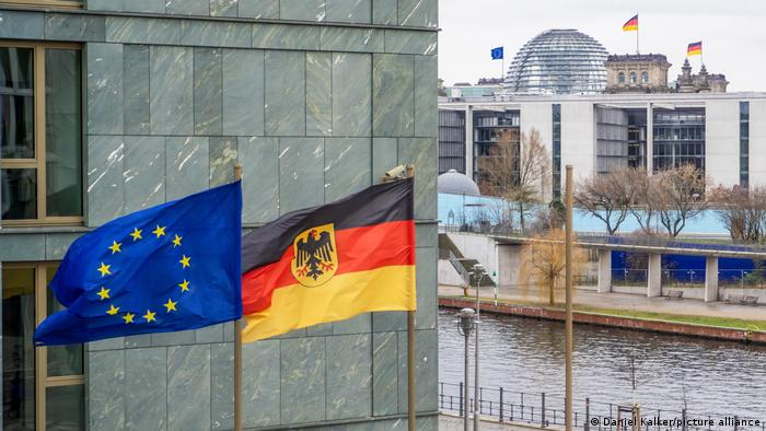 The German and EU flags fly outside the Bundestag