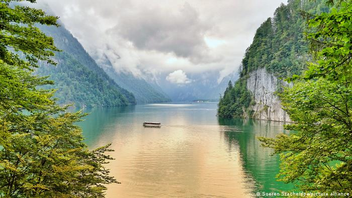 An electric boat crossing Lake Königsee in the Alps at Berchtesgaden, Germany