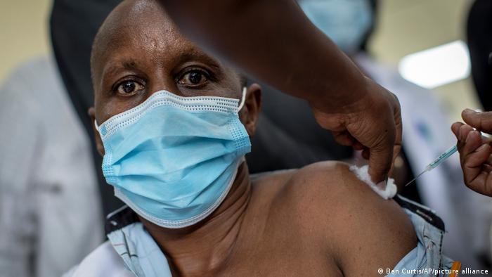 A hospital staff member receives the AstraZeneca vaccine