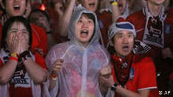 South Korean soccer fans are not afraid to show their emotion