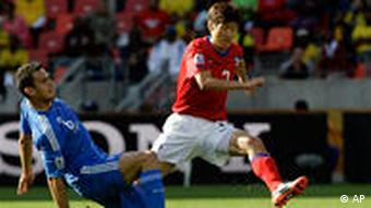 South Korea's Lee Jung-soo dribbles past a Greek player