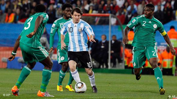 Argentina's Lionel Messi, center, controls the ball as Nigeria's Taye Taiwo, left, Lukman Haruna, second left, and Joseph Yobo, right, look on during the World Cup group B soccer match between Argentina and Nigeria at Ellis Park Stadium in Johannesburg, South Africa, Saturday, June 12, 2010.