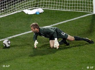 English keeper Robert Green mishandles a Donovan drive in the 40th minute