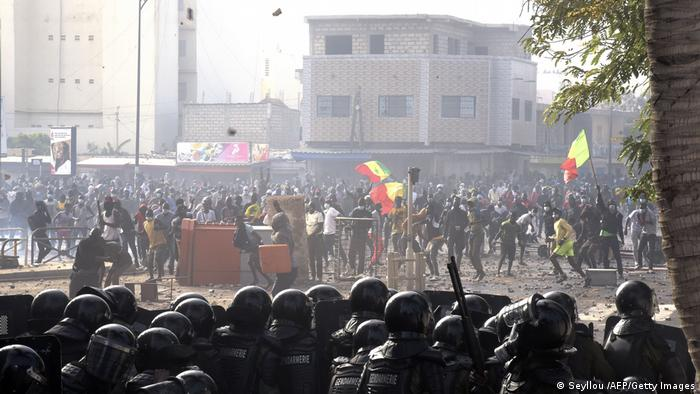 Protesters fight against gendarmes, in the Colobane neighbourhood, in Dakar