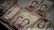 CARACAS, VENEZUELA - DECEMBER 13: Bank Notes of 100 Bolivares are displayed over a counter in a spare part business in Los Teques on December 13, 2016. Venezuelan President Nicolas Maduro on Sunday signed an emergency decree ordering the country's largest banknote, the 100 bolivar bill, taken out of circulation to defeat mafias he accused of hoarding cash in Colombia. Carlos Becerra / Anadolu Agency