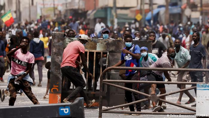 Supporters of opposition leader Ousmane Sonko build a barricade in the street