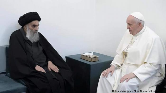 Ali al-Sistani (left) sits down with Pope Francis (right)