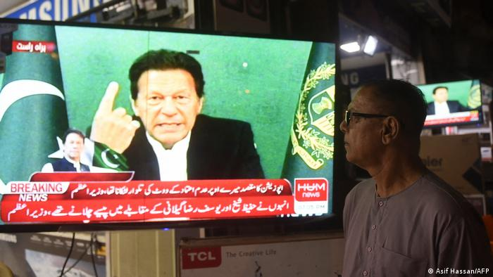 Imran Khan looking defiant during a TV appearance