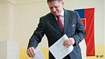 Slovak Prime Minister and leftist Smer party leader Robert Fico casts his ballot