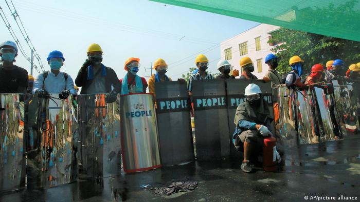 Anti-coup protesters with helmets and homemade shields