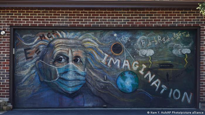 An image of Einstein wearing a mask with the word Imagination written next to him.
