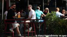 Auckland residents sitting at a cafe