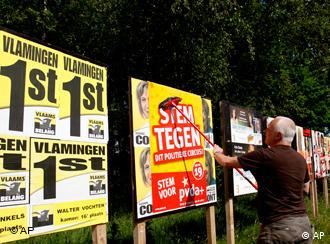 Workers put up election posters in Zoersel, Belgium