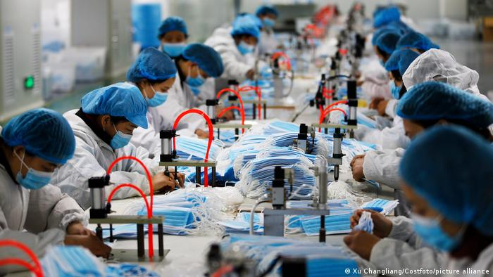 Workers work overtime to produce face masks at a factory in Sihong Economic Development Zone