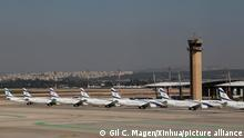 (210125) -- TEL AVIV, Jan. 25, 2021 (Xinhua) -- Airplanes of Israeli airline company El Al park on the tarmac of Ben Gurion International Airport near Tel Aviv, Israel, Jan. 24, 2021. Israeli cabinet approved on Sunday a ban on incoming and outgoing passenger flights to prevent the spread of new coronavirus variants. The shutdown will come into effect at midnight (2200 GMT) between Monday and Tuesday and will last until Jan. 31, according to a statement issued by the Prime Minister's Office. (Photo by Gil Cohen Magen/Xinhua)
