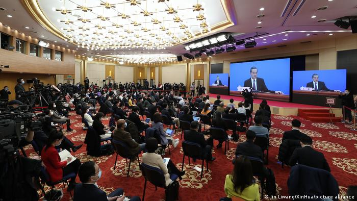 Journalists attend a press conference given by Chinese State Councilor and Foreign Minister Wang Yi via video link