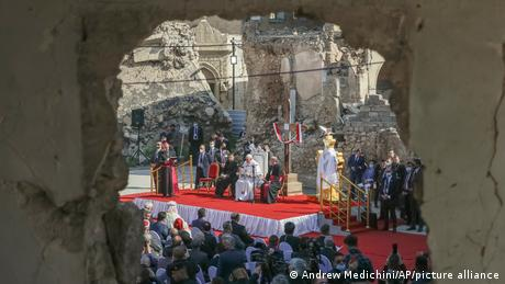 Pope Francis, surrounded by shells of destroyed churches, attends a prayer for the victims of war at Hosh al-Bieaa Church Square, in Mosul, Iraq,