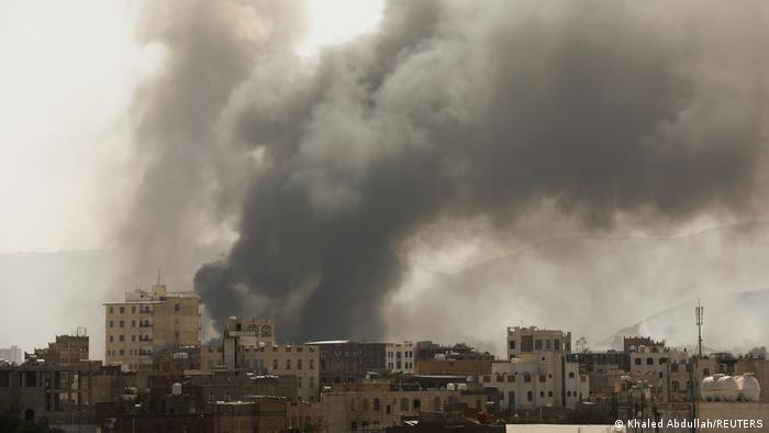 Smoke billows from the site of Saudi-led air strikes in Sanaa, Yemen
