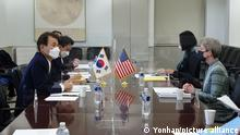S. Korea-U.S. defense cost-sharing talks Jeong Eun-bo (L), South Korea's top negotiator in talks over the sharing of the costs for the upkeep of American troops in South Korea, holds talks with his U.S. counterpart, Donna Welton (R), during the ninth round of negotiations in Washington on March 7, 2021, to agree on the cost-sharing deal, called the Special Measures Agreement, in this photo released by the South Korean foreign ministry. The two sides have reached an agreement on Seoul's share of the burden in maintaining U.S. troops on the Korean Peninsula, the ministry said. (PHOTO NOT FOR SALE) (Yonhap)/2021-03-08 07:28:46/