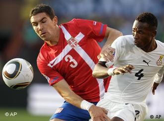 Serbia's Aleksandar Kolarov, left, vies with Ghana's John Pantsil during the World Cup group D soccer match between Serbia and Ghana at the Loftus Versfeld Stadium in Pretoria, South Africa, Sunday, June 13, 2010.