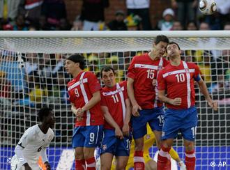 Serbia's wall defends against a free kick on goal