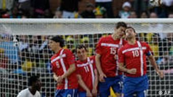 Serbia's players from right, Dejan Stankovic, Nikola Zigic, Nenad Milijas, and Marko Pantelic, form a wall as Ghana's Anthony Annan, left, looks on during the World Cup group D soccer match between Serbia and Ghana at the Loftus Versfeld Stadium in Pretoria, South Africa, Sunday, June 13, 2010.