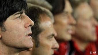 Germany head coach Joachim Loew, left, listens to the German national anthem