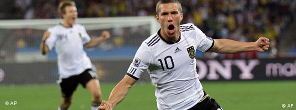 Germany's Lukas Podolski celebrates after scoring during the World Cup Group D soccer match between Germany and Australia at the stadium in Durban, South Africa, Sunday, June 13, 2010