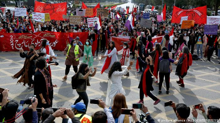 Activists dance at a Women's Day rally in Islamabad