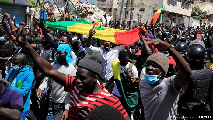 Supporters of opposition leader Ousmane Sonko attend a demonstration in front of the court in Dakar