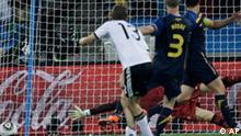 Germany's Thomas Mueller (13) scores his side's third goal past Australia goalkeeper Mark Schwarzer during the World Cup group D soccer match between Germany and Australia at the stadium in Durban, South Africa, Sunday, June 13, 2010. (AP Photo/Julie Jacobson)