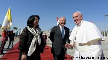 Pope Francis (right) pictured with Iraq's President Barham Salih (center) and his wife Sarbagh Salih (left) before departing from Baghdad International Airport