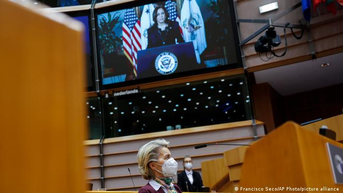 EU President Ursula von der Leyen listens to US Vice President Kamala Harris, displayed in a screen, during a plenary to mark International Women's Day at the European Parliament in Brussels.