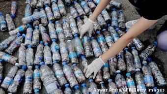 Volunteers sort empty plastic bottles