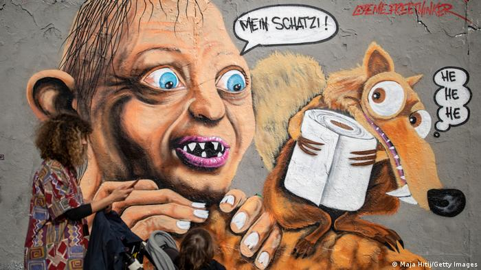 A painting of Gollum from Lord of the Rings saying My precious as he watches the squirrel Scrat from Ice Age stealing a roll of toilet paper.