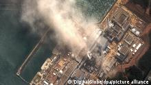 Fukushima I nuclear power plant in Japan is seen in this satellite photo taken Monday, March 14, 2011 after a second explosion - this time in reactor 3. A tsunami and a strong earthquake hit the region on Friday. *** ACHTUNG REDAKTIONEN: VERWENDUNGNURFÜRREDAKTIONELLEZWECKEMITDEMURHEBERHINWEIS: «Foto: DigitalGlobe» ++
