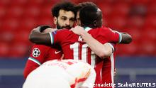 Soccer Football - Champions League - Round of 16 Second Leg - Liverpool v RB Leipzig - Puskas Arena, Budapest, Hungary - March 10, 2021 Liverpool's Mohamed Salah celebrates scoring their first goal with teammates REUTERS/Bernadett Szabo