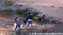 Migrants cross the Rio Bravo river to turn themselves in to U.S Border Patrol agents to request for asylum in El Paso, Texas, U.S., as seen from Ciudad Juarez, Mexico March 4, 2021. REUTERS/Jose Luis Gonzalez