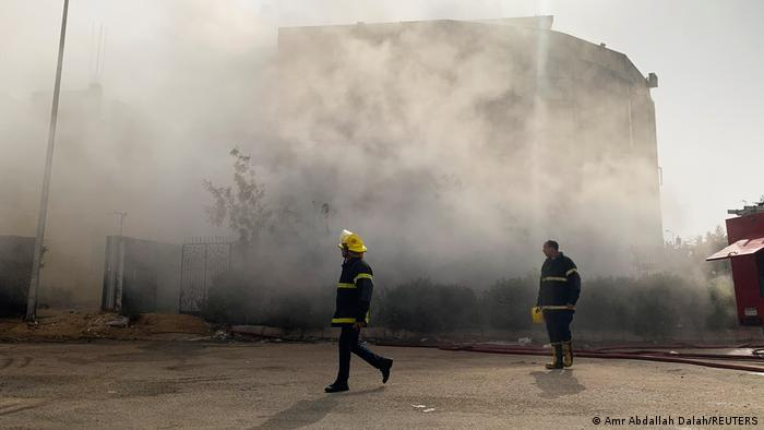 Firefighters are seen at the scene after a fire broke out in a garment factory north of Cairo, Egypt
