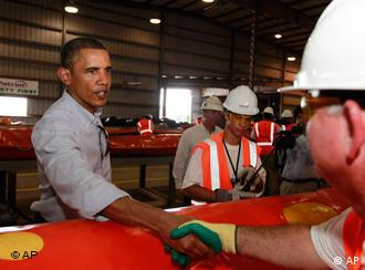 U.S. President Obama shakes the hand of an oil spill worker