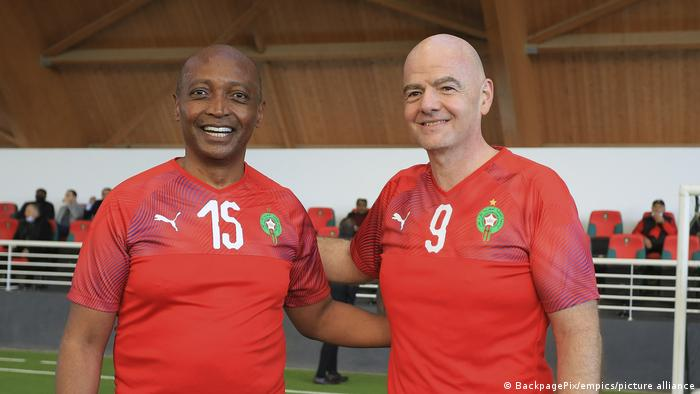 Patrice Motsepe, of the CAF, and FIFA President Gianni Infantino at a match in Morocco