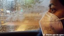 Deutschland Regenwetter und Maskenpflicht
