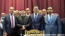 Libyan Prime Minister Abdul Hamid Dbeibeh (second from right) and members of the Libyan parliament