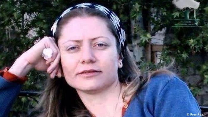 Razan Zaitouneh rests her head on her arm