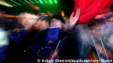 People celebrate with EU and Romanian flags during the countdown for 2007, at University Plazza in Bucharest, Monday 01 January 2007. On 01 January 2007, Romania officially joined European Union. EPA/ROBERT GHEMENT +++(c) dpa - Report+++