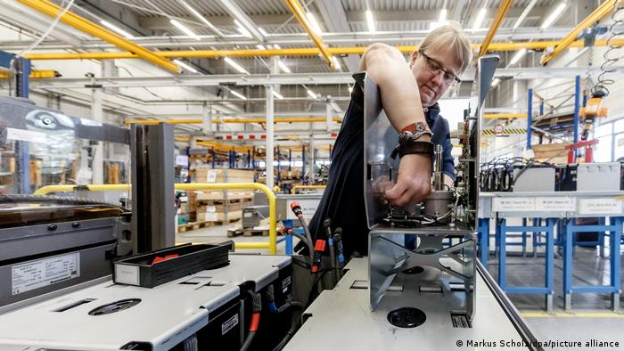 Worker constructs a Lithium-Ion battery in a European factory