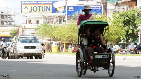 A cyclo driver pedals one of the shrinking number of Cambodians who use this traditional form of getting around Phnom Penh.