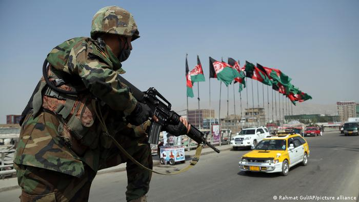 An Afghan National Army soldier stand guard at a checkpoint in Kabul ahead of presidential elections in September 2019